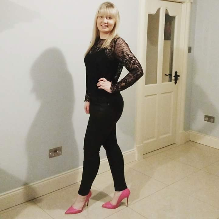 Amie VIP wearing high waisted pleather leggings from H&M with a long sleeve lace top and bright pink stilettos from Penneys