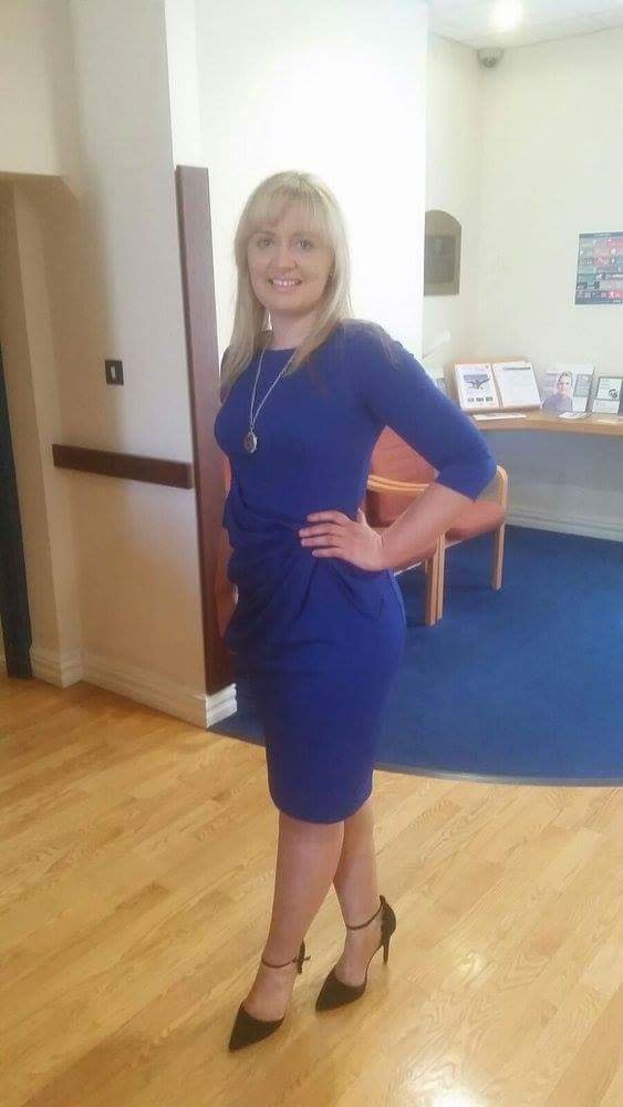 Amie VIP In a royal blue midi dress from Love Virgo Boutique with black stilettos