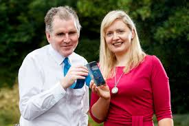 Picture of Amie Hynes Fitzpatrick and Stuart Lawler holding an iPhone