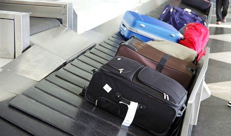 Suitcases on an airport carousel