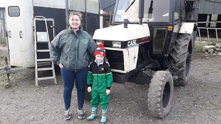 Amie Hynes Fitzpatrick standing with her amazing nephew Sean Desmond on the family farm